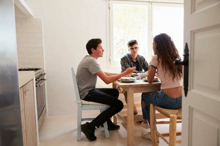 tenants sitting at kitchen table discussing coronavirus
